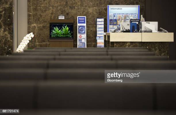 An information counter stand at the Mizuho Bank Ltd branch inside the Mizuho Financial Group Inc headquarters in Tokyo Japan on Friday April 21 2017...