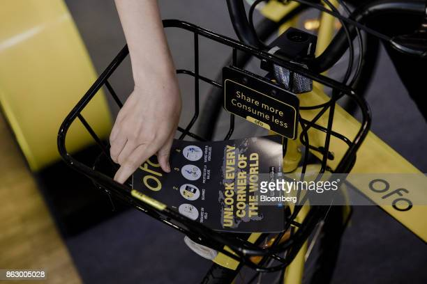 An information leaflet is placed into the basket of a Ofo Inc hire bicycle during a presentation at the Autonomy urban mobility summit in Paris...