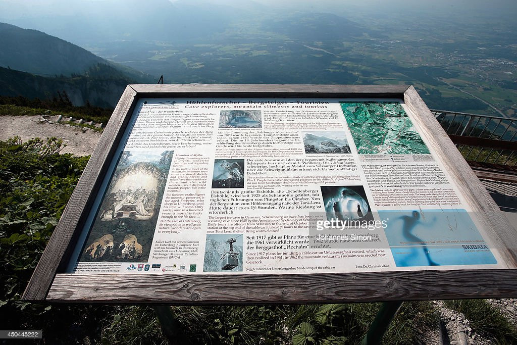 An information plaque for visitors about the Untersberg cave system and their historic circumstances, near an underground cave where an explorer is lying injured 1,000 meters below on June 11, 2014 near Marktschellenberg, Germany. The man, along with two colleagues, was exploring the Riesending vertical cave, which is over 20km long and up to 1,148 meters deep, when he was struck by rocks and severely injured. Since then specialist rescue workers from Switzerland and Italy have arrived to help with the arduous rescue effort, which could take up to several more days and even weeks.