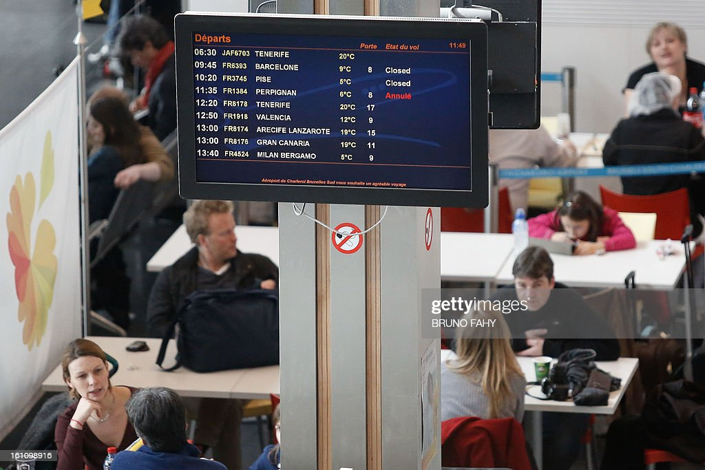 An information screen displays delayed and cancelled flights at the airport after a Cessna passenger plane crashed on February 9, 2013 at Brussels South airport in Charleroi. It appears that the plane experienced problems on take-off and returned to the airport but crashed next to the runway as it attempted a landing. Five people died in the accident. AFP PHOTO / BELGA / BRUNO FAHY -
