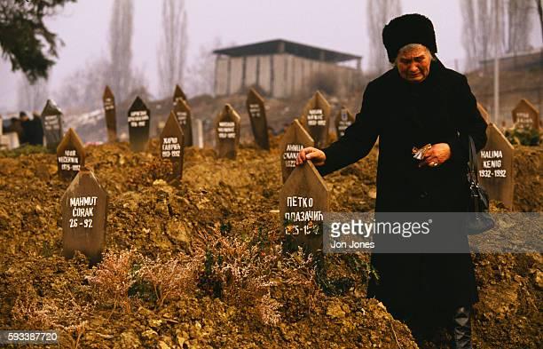 An inhabitant of wartorn Sarajevo visits a graveyard on Christmas eve