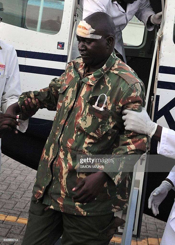 An injured adminstration police officer arrives in Nairobi to receive medical treatment with 28 other injured police officers injured, on May 24, 2016, following clashes with opposition protestors, who were demanding removal of the Independent Electoral and Boundaries Commission (IEBC) electoral body, ahead of next year's election in Nairobi. The opposition protests, in their fourth week, are organised by the CORD party and aimed at forcing a change of leadership at the country's Independent Electoral and Boundaries Commission (IEBC) ahead of polls due next year. / AFP / SIMON