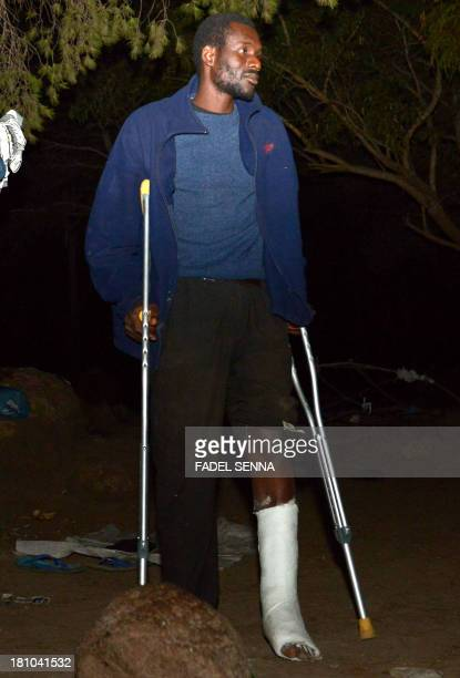 An injured African migrant hides in a forest near the eastern coastal city of Nador on September 18 2013 after roughly 300 migrants trying to enter...