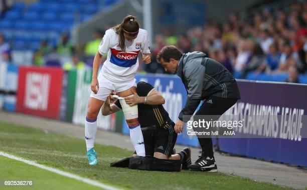 An injured Alex Morgan of Olympique Lyonnais has her leg bandaged during the UEFA Women's Champions League Final match between Lyon and Paris Saint...