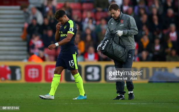 An injured Alex OxladeChamberlain of Arsenal leaves the pitch during the Premier League match between Southampton and Arsenal at St Mary's Stadium on...