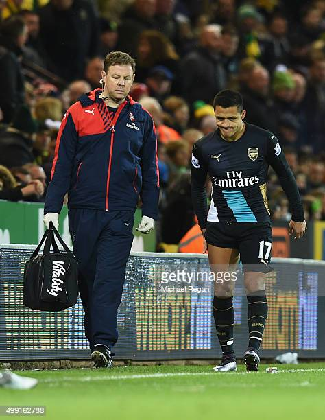 An injured Alexis Sanchez of Arsenal leaves the pitch during the Barclays Premier League match between Norwich City and Arsenal at Carrow Road on...