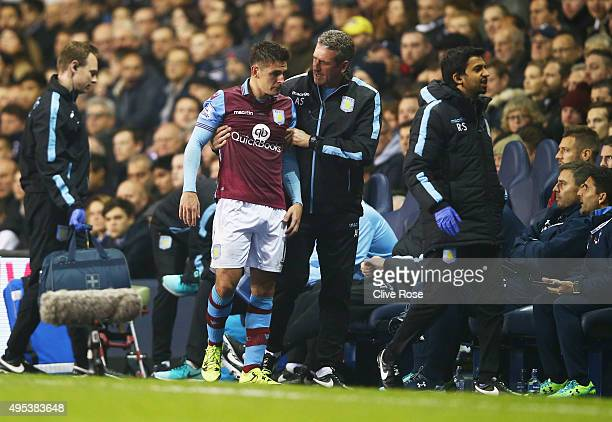 An injured Ashley Westwood of Aston Villa is given assistance as he is substituted during the Barclays Premier League match between Tottenham Hotspur...