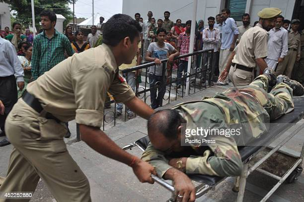 An injured Border Security Force soldier after their cross fire encounter with the Pakistan in Arnia Subsector of Jammu District was rushed in the...