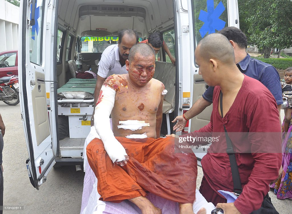 An injured Buddhist monk receives medical treatment after low-intensity serial blasts at the Bodhgaya Buddhist temple complex on July 7, 2013 in Bihar, India. Nine serial explosions today rocked the internationally renowned temple town of Bodhgaya. Two people have been injured in a series of blasts inside the Mahabodhi temple in Bihar's Bodhgaya district.