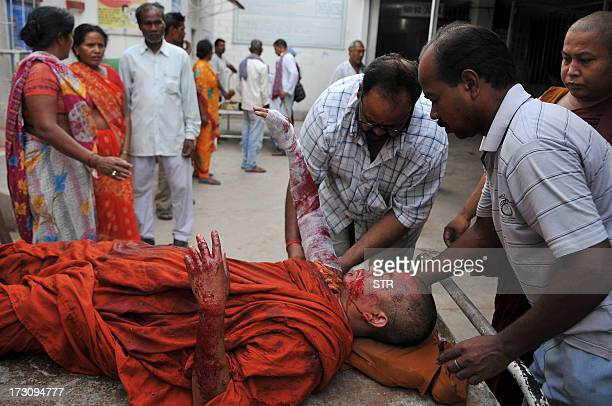 An injured Buddhist monk receives medical treatment following eight lowintensity serial blasts at the Bodh Gaya Buddhist temple complex at a hospital...