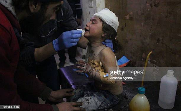 An injured child receives treatment at a military hospital after an airstrike which left 6 children dead and 8 civilians injured at a farm where...