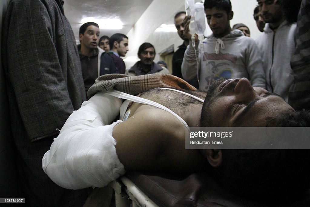 An Injured Civilian on a stretcher in a hospital following an encounter between army and militants in Pulwama district of South Kashmir, on December 28, 2012 in Srinagar, India. Two top Lashkar-e-Taiba (LeT) militants were killed, while one Major, one captain of army, one policeman and Seven Civilians were injured in the encounter.