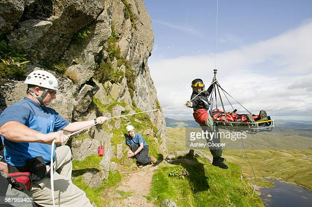 an injured climber with a dislocated shoulder is whinched off Jacks Rake Pavey Ark by the Langdale Ambleside Mountain rescue Team