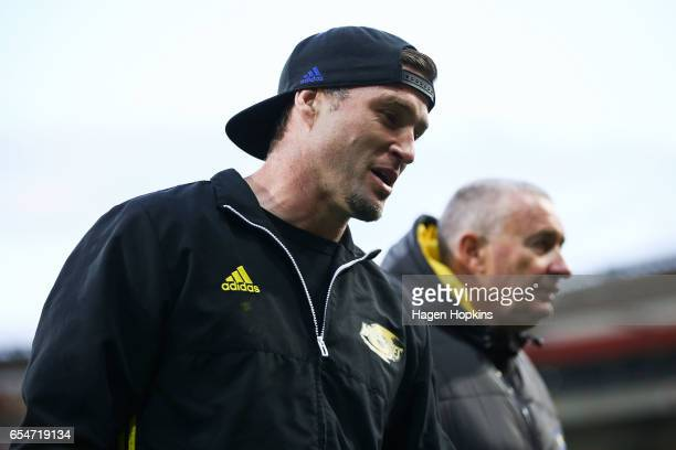 An injured Cory Jane and Coach Chris Boyd of the Hurricanes look on during the round four Super Rugby match between the Hurricanes and the...