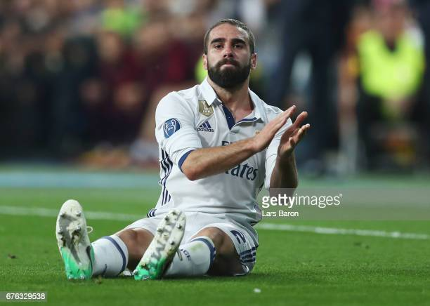An injured Daniel Carvajal of Real Madrid applauds during the UEFA Champions League semi final first leg match between Real Madrid CF and Club...