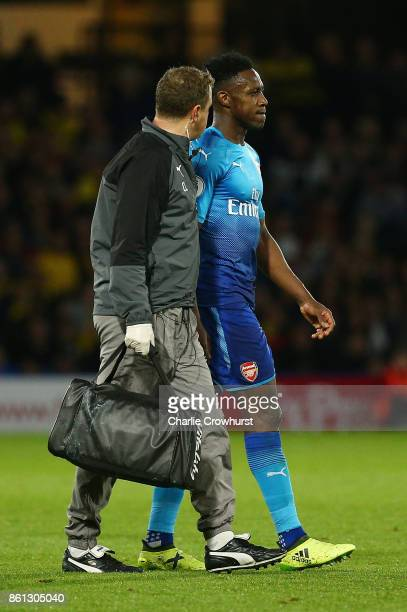 An injured Danny Welbeck of Arsenal leaves the pitch during the Premier League match between Watford and Arsenal at Vicarage Road on October 14 2017...