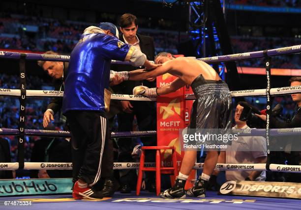 An injured Darleys Perez recieves treatment during his fight against Luke Campbell in action during the WBA Leightweight Eliminator bout at Wembley...