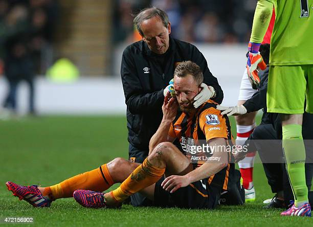 An injured David Meyler of Hull City is given treatment during the Barclays Premier League match between Hull City and Arsenal at KC Stadium on May 4...