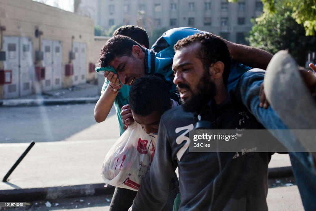 An injured Egyptian is carried away from clashes near the United States Embassy and Tahrir Square on September 14, 2012 in Cairo, Egypt. Over two hundred people have been injured in clashes between protesters and security forces. Protests have continued into a fourth day in central Cairo, with Egyptians demonstrating against a US-made film said to be defaming the Prophet Mohammed, whose trailer had recently been released on Youtube and translated into Arabic. Egyptian authorities began construction of a concrete barrier early Friday morning to stop demonstrations planned across the country for Friday from reaching the US Embassy, after Egyptians demonstrated at the Embassy compound and breached its perimeter walls on Tuesday.