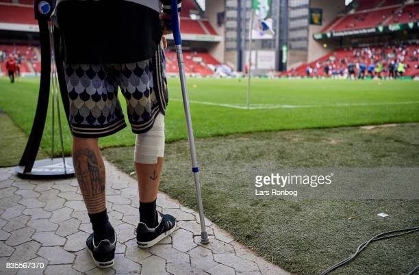 An injured Erik Johansson of FC Copenhagen on crutches watching the warm up prior to the Danish Alka Superliga match between FC Copenhagen and...