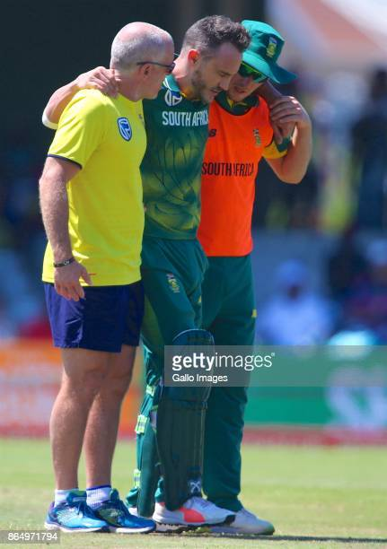An injured Faf du Plessis of South Africa is helped off the field during the 3rd Momentum ODI match between South Africa and Bangladesh at Buffalo...