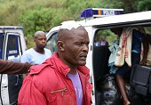An injured foreign national is escorted by members of the South African Police Service after a xenophobic attack in Durban on April 8 2015 Hundreds...