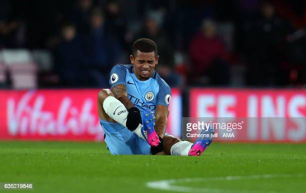 An injured Gabriel Jesus of Manchester City holds his leg during the Premier League match between AFC Bournemouth and Manchester City at Vitality...