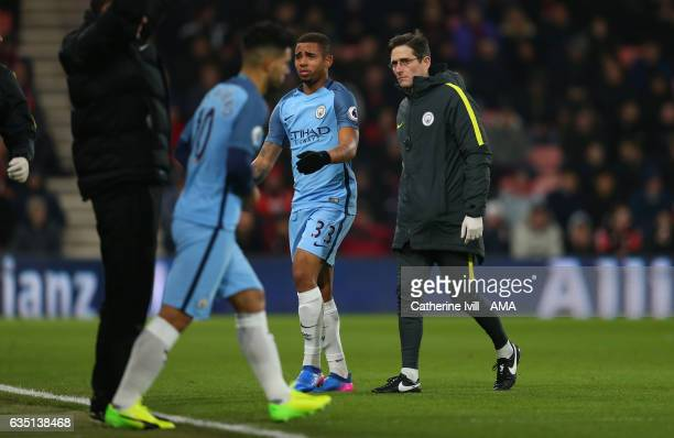 An injured Gabriel Jesus of Manchester City leaves the pitch as Sergio Aguero of Manchester City prepares to come on during the Premier League match...