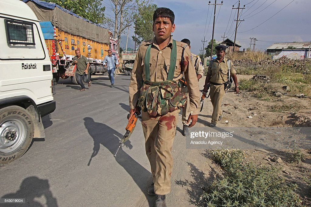 An injured Indian paramilitary soldier leave the shootout spot in Pampore, on the outskirts of Srinagar, the summer capital of Indian controlled Kashmir on June 25, 2016. Eight Indian paramilitary soldiers were killed and other 20 were injured in the shootout when suspected militants attacked the convoy of Indian paramilitary soldier on Jammu and Kashmir National highway. Later police said two unidentified militants were also killed where the shootout took place.