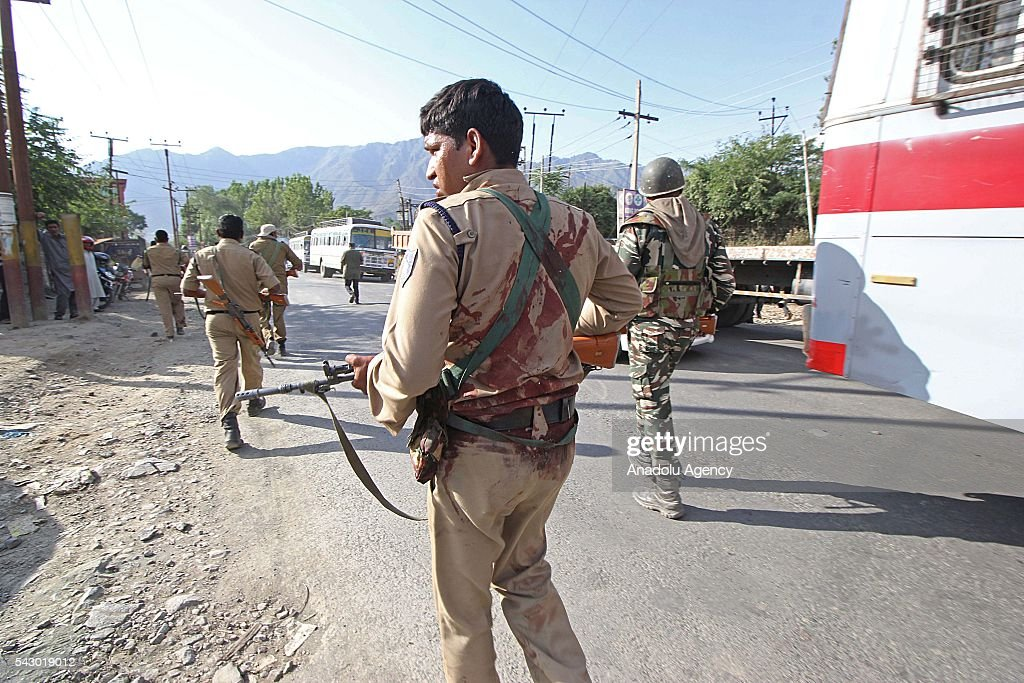 An injured Indian paramilitary soldier leaveS the shootout spot in Pampore, on the outskirts of Srinagar, the summer capital of Indian controlled Kashmir on June 25, 2016. Eight Indian paramilitary soldiers were killed and other 20 were injured in the shootout when suspected militants attacked the convoy of Indian paramilitary soldier on Jammu and Kashmir National highway. Later police said two unidentified militants were also killed where the shootout took place.