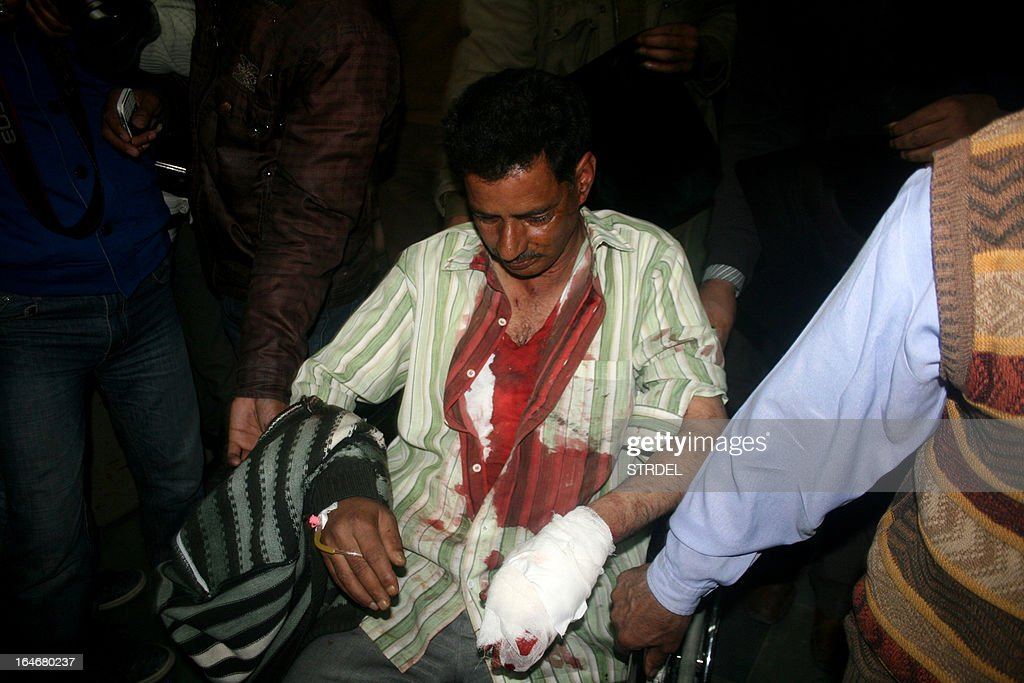 An injured Indian policeman is wheeled into a hospital in Srinagar on March 26, 2013, after a grenade accidentally exploded in a police station. Four policemen were injured when a grenade exploded accidentally in the premises of a police station in the city as a bomb disposal squad was inspecting some seized ammunition and explosives.