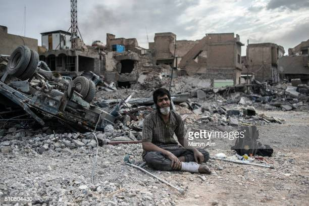 An injured Iraqi man who has been detained from among civilians and suspected of being an Islamic State militant by Iraqi forces cries in the...
