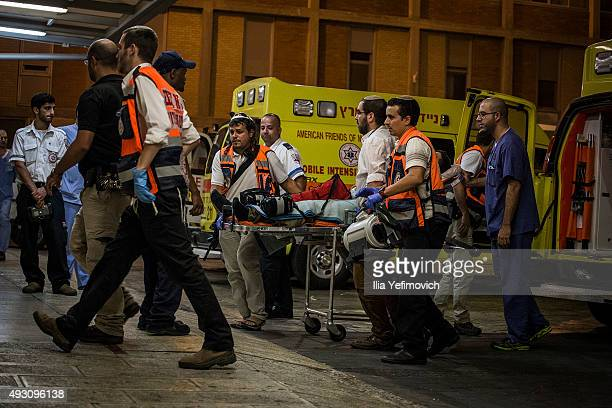 An injured Israeli soldier is seen as ambulance arrived to Hadas hospital on October 17 2015 in Jerusalem Israel Israeli soldier was stabbed in...