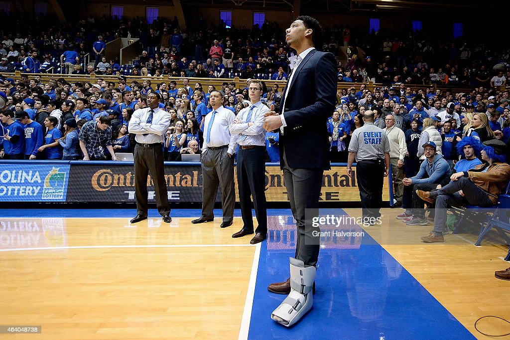 An injured Jahlil Okafor of the Duke Blue Devils watches from the sidelines as his team warms up before a game against the Clemson Tigers at Cameron...