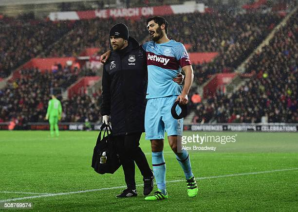 An injured James Tomkins of West Ham United is given assistance during the Barclays Premier League match between Southampton and West Ham United at...