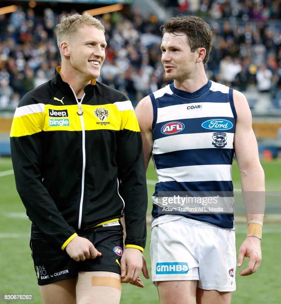 An injured Josh Caddy of the Tigers chats to former Cats teammate Patrick Dangerfield during the 2017 AFL round 21 match between the Geelong Cats and...