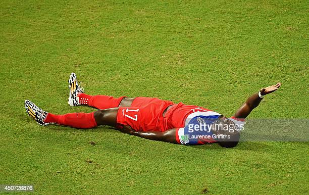 An injured Jozy Altidore of the United States lies on the field during the 2014 FIFA World Cup Brazil Group G match between Ghana and the United...