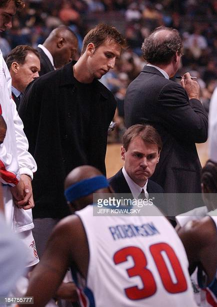 An injured Juan 'Pepe' Sanchez from Argentina listens to Detroit Pistons' Coach Rick Carlisle during a timeout in the third quarter against the New...
