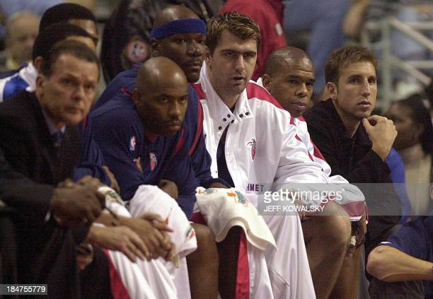 An injured Juan 'Pepe' Sanchez sits on the bench during the first quarter on 30 October 2002 at the Palace of Auburn Hills Michigan Sanchez has right...
