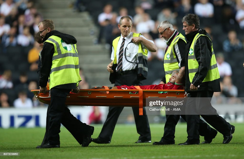 An injured Kyle Bartley of Swansea City is taken off on a stretcher during the Carabao Cup Second Round match between Milton Keynes Dons and Swansea City at StadiumMK on August 22, 2017 in Milton Keynes, England.