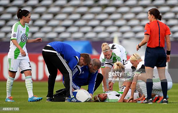 An injured Lena Goessling of VfL Wolfsburg is given assistance during the UEFA Women's Champions Final match between Tyreso FF and Wolfsburg at Do...