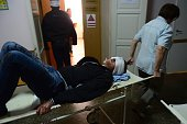 An injured man arrives on a stretcher at hospital after a shelling in Donetsk on October 1 2014 Ten civilians died in attacks in Ukraine's rebelheld...
