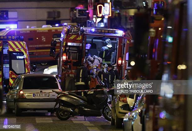 An injured man is evacuate following an attack in the 10th arrondissement of the French capital Paris on November 13 2015 At least 18 people were...