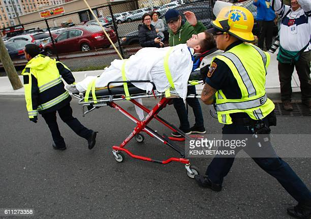 An injured man is evacuated at New Jersey Transit's rail station in Hoboken New Jersey September 29 2016 A commuter train crashed into a station in...