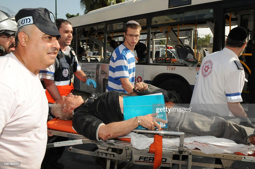 An injured man is evacuated by Israeli medics after a blast ripped through a bus near the defence ministry in Tel Aviv on November 21, 2012. At least 10 people were injured in an explosion on a bus, Israel's emergency services said, in what an official said was 'a terrorist attack.'
