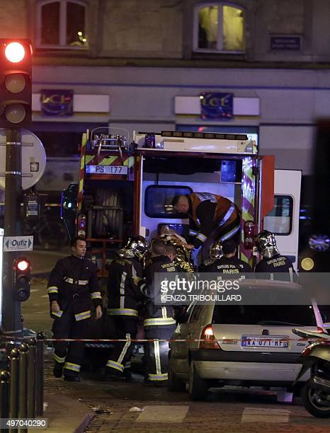 An injured man is put into an ambulance following an attack in the 10th arrondissement of the French capital Parison November 13 2015 At least 18...