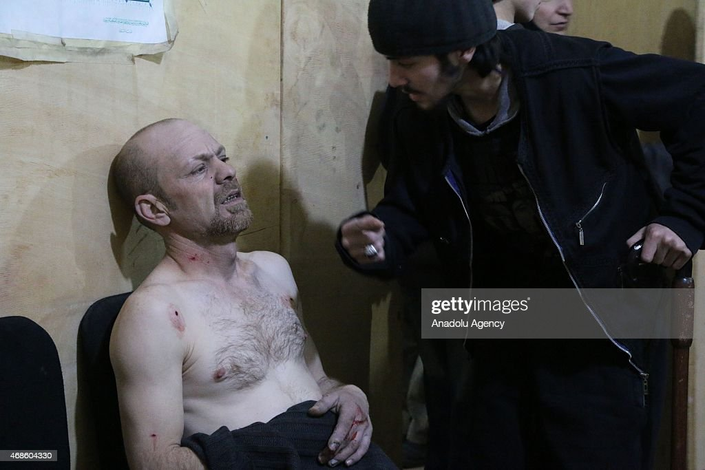 An injured man is seen at a hospital after a Syrian army warcraft carried out airstrikes on the Cobar region of Damascus which is under the control...