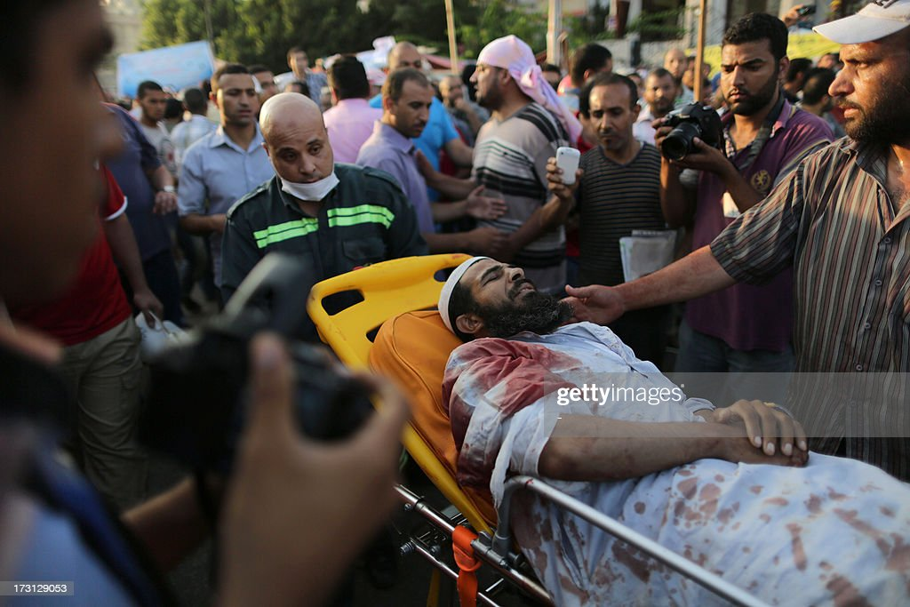 An injured man lies on a gurney as he is brought for medical treatment in Cairo following overnight violence, on July 8, 2013. Forty-two loyalists of Egypt's ousted president Mohamed Morsi were killed while demonstrating against last week's military coup, with the Egyptian military blaming 'terrorists' for the violence, while witnesses, including Islamic Brotherhood supporters, telling AFP that the armed forces fired only tear gas and warning shots and that 'thugs' in civilian clothes had carried out the deadly shooting.