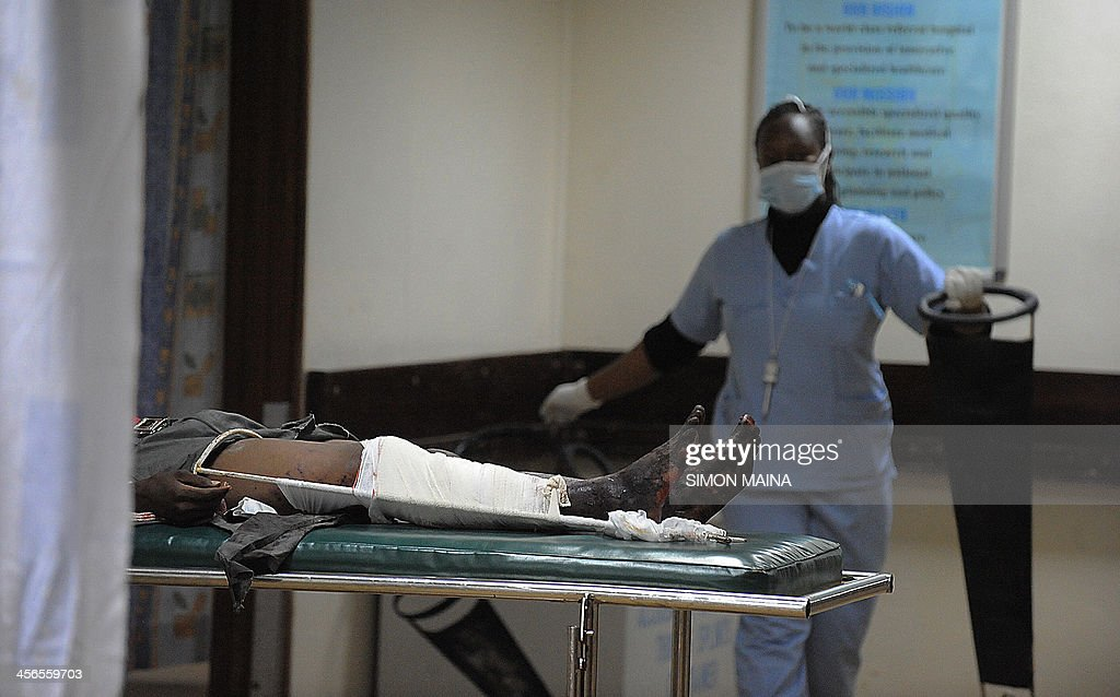 An injured man lies on a hospital bed at the Kenyatta national Hospital, after he was injured in an explosion near Nairobi's Eastleigh neighbourhood on December 14, 2013, in Nairobi. Four people were killed in Nairobi Saturday when assailants threw a grenade on a bus, the Kenyan interior ministry said. More than a dozen other people on the 32-seat bus were wounded, according to officials and the Kenyan Red Cross. AFP PHOTO/SIMON MAINA