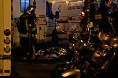 An injured man lies on a stretcher near the Bataclan concert hall in central Paris on November 14 2015 At least 39 people were killed in an...